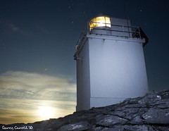 Black Head Lighthouse 1 (garryjosephcarroll) Tags: county ireland light red moon lighthouse black rock night canon stars rebel long exposure clare head flash trail limestone burren munster 500d t1i