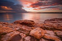 Coloured rocks at Fannie Bay (Nolan Caldwell) Tags: sunset cloud storm weather canon rocks harbour nt australia darwin northernterritory topend wetseason fanniebay eos50d leefilter bestofaustralia australiathunderstorms passiondclic