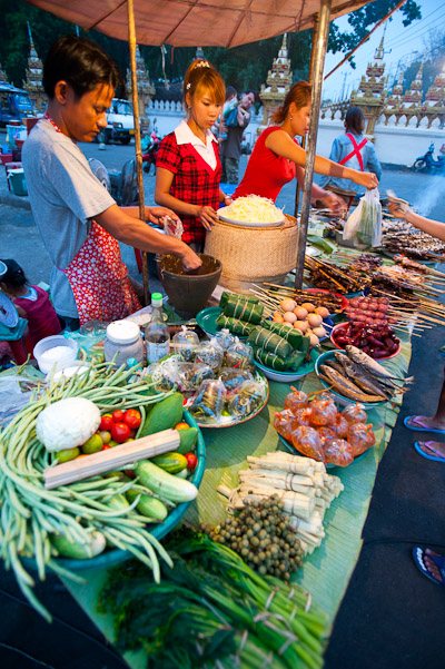 Vendors at Vientiane's Pha That Luang Evening Market, Laos