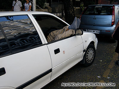 Spotted quite a few people sleeping this way in their cars - is this a trend?