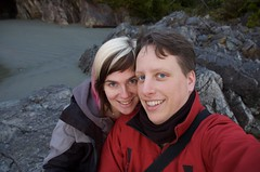 Susie and Travis in Tofino (nep) Tags: red beach rock pose couple jacket travis travissmith supersusie
