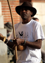 Angola Capoeira Band Leader 2 (Paul 'Tuna' Turner) Tags: plaza city travel vacation music holiday france musicians canon square french europe band palace government townhall toulouse oldtown southoffrance folkmusic franais languedoc westerneurope capitole cite musicschool midipyrenees africanmusic neoclassicalarchitecture thepinkcity placeducapitole canoneos400d levillerose angolanmusic