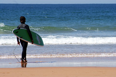 Humanity (Massimo Valiani) Tags: sea summer sky green portugal fight sand surf waves wind humanity surfer sony unknown exploration cascais massimo approaching a350 valiani