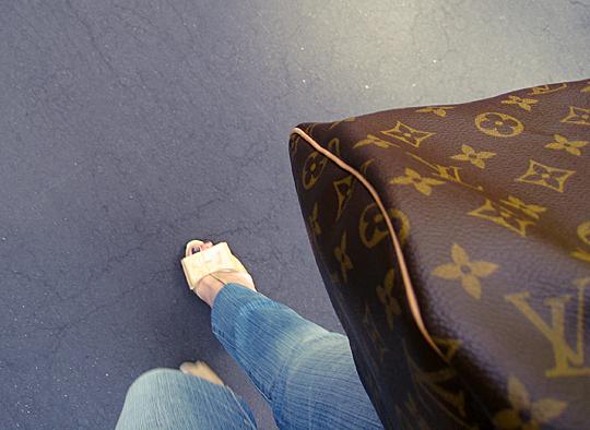 patent bow heels+louis vuitton bag closeup