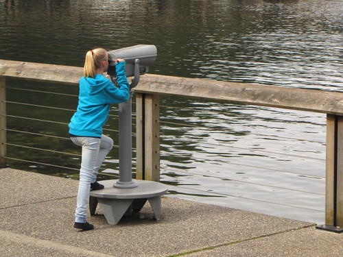 Young girl enjoys the view at Horseshoe Bay through a telescope