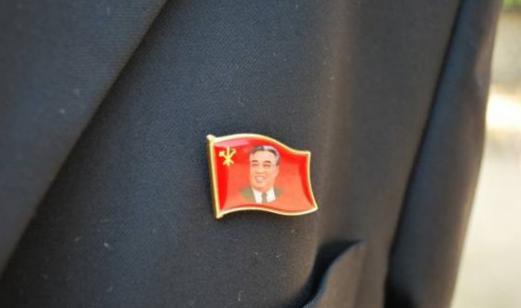 Ubiquitous Kim Jong Il Badges