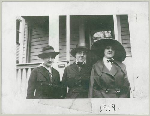 Three women and hats
