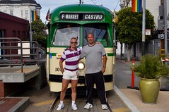 Carl and I in front of a F-Market Trolley line in the Castro District - San Francisco, California (Blue Rave) Tags: bloke building buildings dude guy male mate men people shorts transportation guys dudes blokes faces city trolley streetcar castro castrodistrict me sanfrancisco self destinationunknown ego myself selfportrait 2010 face mostinteresting mostinterestingvol1 california ca