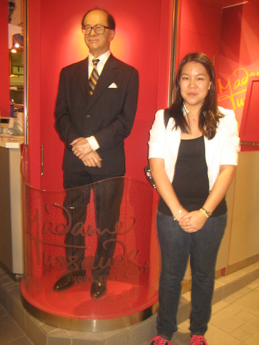 j with a wax figure.