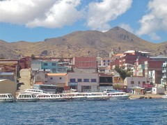 A view of #Copacabana from #LakeTiticaca. These are some of the #TourBoats that will take passengers from Copacabana to #IslaDelSol. #TreasuresOfTraveling abound in this part of #Bolivia so check out these 6 things to do when visiting Copacabana in #South (TreasuresOfTraveling) Tags: copacabana isladelsol tourboats southamerica bolivia treasuresoftraveling laketiticaca