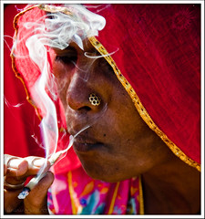 Smoking Lady in Red :) (Yug_and_her) Tags: life travel red portrait woman india lady gold costume nikon dress candid indian smoke traditional local smoker ethnic incredible saree beedi rajasthani d90