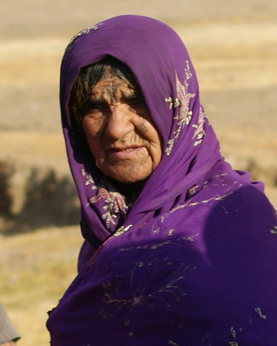 The faded tattoo markings on this Afghan elder show the hardship in which