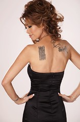 one's life story .. inked (Liz Lieu) Tags: tattoos spiritual 2010 cocktaildress lizlieu thepokerdiva propokerplayer chilipokercom advertisingbanner paliwordsofwisdom astoryofoneslifedottedinink