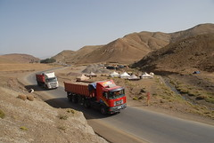 TRUCKING IN MOROCCO (Claude  BARUTEL) Tags: africa man mountains sahara truck desert morocco atlas roads trucking