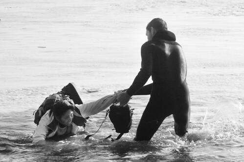 Mavericks Rogue Waves: Surfer Lending a Helping Hand