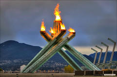Vancouver's Olympic Flame (Clayton Perry Photoworks) Tags: sky canada skyline vancouver clouds bc britishcolumbia canadian explore flame torch olympic olympics hdr 2010 olympicflame wintergames vancouver2010 vancouverolympics olympicwintergames olympiccauldron van2010 vancouverwinterolympics olympicswintergames hdrcreativeshots hdrspotting claytonperry vancouverwintergames