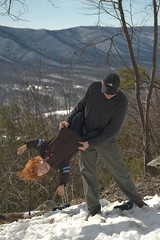 Checking for Candy, Firecrackers, Money, Etc. (jon_beard) Tags: winter boy snow hair fun child play hiking father son swing laugh teaparty kiva