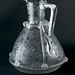Clear glass jug divided in to panels by vertical & horizontal trails, c.1880