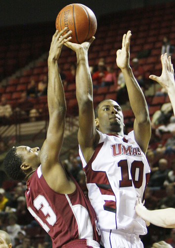 February 14, 2010 - Javorn Farrell goes for the basket as Hawk's Darrin Govens tries to steal the ball.