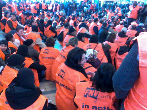 "A Hundred Cleaners conducting a ""sit-in"" at a workplace"