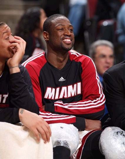 D-Wade wasnt smiling because he was happy to be back in Chicago.