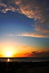 sunset on the bay (james.lawlor) Tags: blue sea sky orange sun clouds canon landscape 50mm bay coast twilight rocks shadows sundown dusk tide lancashire coastal land shallow scape amateur morecambe morecambebay 450d jameslawlor