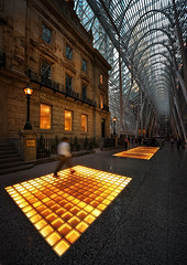 Warmth (Philipp Klinger Photography) Tags: blue roof santiago light sky people orange toronto ontario canada man motion blur reflection window glass lamp lines yellow metal architecture stairs america movement nikon warm long exposure pattern hand allen place floor geometry ghost north pillar royal warmth bank ceiling calatrava brookfield handheld marble held lambert pillars