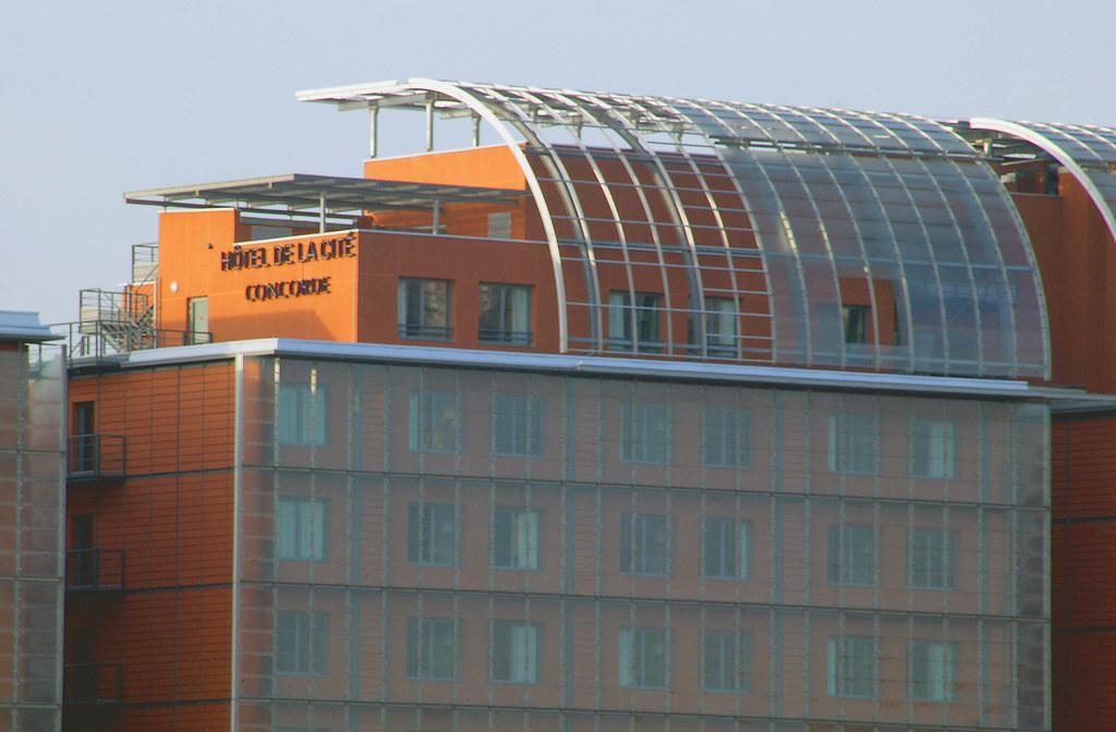 Orange Facade and Modern Rooftop at the Hotel Concorde de la Cite in Lyon France