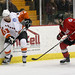 Darcy Zajac #13 of the Adirondack Phantoms plays the puck with Jason Lepine #21 of the Albany River Rats nearby