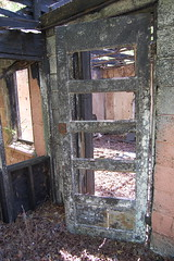 Charred Door (HabitualCocktail) Tags: fire abandonedbuilding charred naturereclaimed