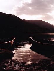 (Monica Forss) Tags: nepal sunset lake film water analog 35mm canon boats asia fuji analogue pokhara travelphotography canoneos1000