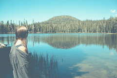 (emily golitzin) Tags: california anna lake reflection water girl flannel lassen explored canonefs1855mmf3556is canoneosdigitalrebelxsi bythewaynoididnotaddthatvignette ihatevignettesoo