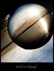 mirrorball (John Liot) Tags: sunset sea ball transparency jersey inverted contactball leoface johnliot