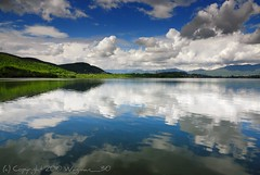 Reflections... (Fabio Montalto) Tags: sky italy lake clouds reflections scenery lombardia nikond200 colorefexpro corgeno nikfilters superaplus aplusphoto excellentphotographerawards platinumheartaward absolutelystunningscapes capturenx2 wagman30 flickrclassique flickraward platinumpeaceaward bestcapturesaoi elitegalleryaoi mygearandmepremium mygearandmebronze mygearandmesilver mygearandmegold lakecomabbio