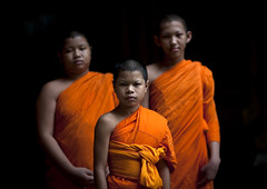 Buddhist novices, Bangkok, Thailand (Eric Lafforgue) Tags: portrait people color colour face kids thailand war asia peace bangkok buddhist events capital religion teenagers monk bouddha explore human civilwar asie capitale couleur visage thailande novice humain darkbackground 5857 centralworld photocouleur