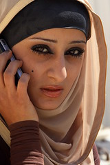 jordan (Retlaw Snellac) Tags: travel woman face photo eyes women phone amman hijab jordan bella portraitworld