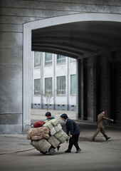 Hard life in the steets of Pyongyang - North Korea (Eric Lafforgue) Tags: poverty life street war asia mother son scene korea asie dailylife coree northkorea pyongyang dprk coreadelnorte nordkorea 4629    coreadelnord   insidenorthkorea  rpdc  kimjongun coreiadonorte