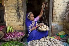 SELLING POTATOES (Dick Verton) Tags: travel blue woman india potatoes asia market varanasi streetshot vegatables