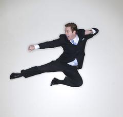 Businessman karate kick