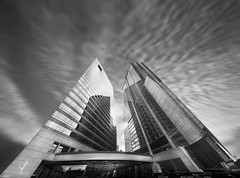 The Two Towers (A 505n State Street Vertorama) (Tomasito.!) Tags: city sky urban panorama usa sun distortion chicago blur reflection building art love glass lines architecture clouds america photoshop silver macintosh concrete illinois mac nikon power steel flash great gray cement surreal monotone lotr mammoth stitching conceptual nikkor beautifulclouds colossal flashblur tallbuilding thetwotowers cs4 wideanglelens tomasito warping ultrawideangle d90 nikkorfisheye nikond90 vertorama jtnoriega mygearandme mygearandmepremium 505statestreet