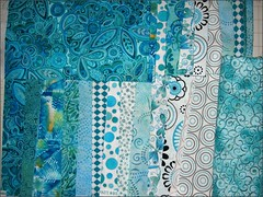 Teal fabrics ready to sew
