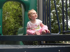 Lily Looking at Daddy after climing up the play thingie