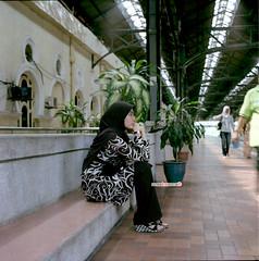KTM Series - Ella Waiting (mankamen et ella) Tags: woman 120 6x6 tlr square lens reflex kodak muslim islam hijab twin ktm mat 124g malaysia pro medium format kuala malaysian milf yashica melayu lumpur malay fju tanah 160 80mm rsm yashinon keretapi ektacolor filmforever manilovefilm randomshotmalaysia filmjunkiesunite filemmalaya