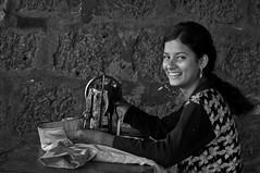 Pallavi - The Innocence of a laughing seamstress at Sangolda, Goa (Anoop Negi) Tags: road school portrait baby india girl shop photography for photo student media image photos sweet delhi indian side bangalore goa working creative babe images best po innocence seamstress mumbai anoop tailor negi mapusa goan photosof ezee123 bestphotographer sangolda imagesof anoopnegi jjournalism