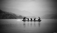 Steal Compass - Drive North - Disappear (Stephan Geyer) Tags: nepal people blackandwhite bw lake mountains water monochrome canon dark boat blackwhite scary eerie canoe rowing 5d canon5d splash pokhara nepali canoneos5d 8512 85l ef85mmf12lusm the4elements canon5dclassic featuredonadidap