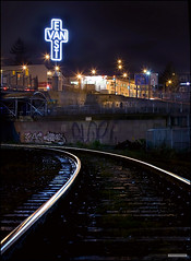 Wrong Side Of The Tracks (Clayton Perry Photoworks) Tags: city sky streetart canada sign night vancouver canon lights graffiti bc britishcolumbia tag tracks rail railway tagged east signage van skytrain eastvan taging wrongsideofthetracks kenlum eastvancross claytonperry