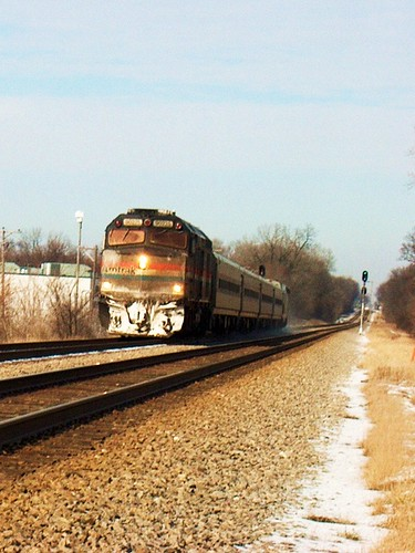 Southbound Amtrak Hiawatha train approaching the Metra Forest Glen commuter flagstop depot. Chicago Illinois. January 2007.