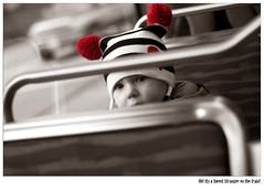 Sweet Stranger (Veevake) Tags: seattle red cute hat li kid nikon flickr meetup duo lightrail d60 flickrite selectivecoloring 50mmf14g veevake imagehallucinations stroll100116