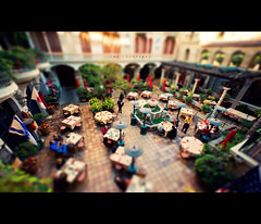 The Courtyard (isayx3) Tags: california people nikon riverside vibrant sigma wideangle courtyard flags tables faux resturant f28 d3 tiltshift 14mm plainjoe themissioninn isayx3