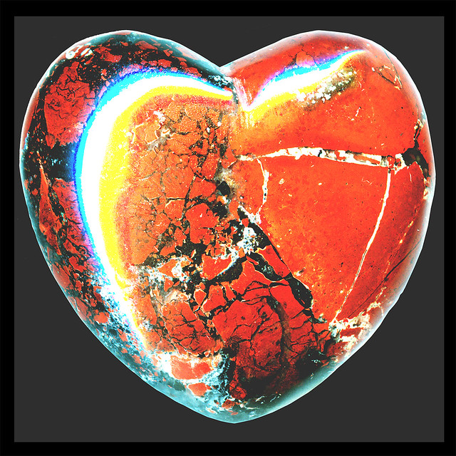 hearts′ empath ♥ brick-red ♥ brecciated jasper & black hematite stylized as an aphrodisiac silphion seed overdubbed by a tricolor broken-hearts-symbol ಌ